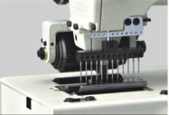 Máy may công nghiệp, 12 kim, mủi móc xích kép, có trợ lực sau - Hiệu Britex, Model: BR-1412P.